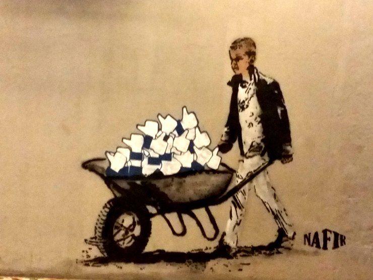 Nafir's boy with wheelbarrow of Likes along Nagore