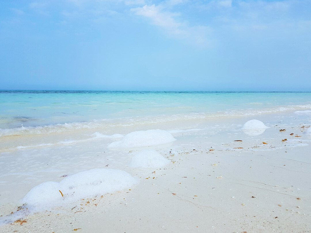 fuwairit beach qatar sea foam